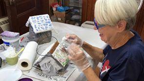 Judy Fannin working on pottery shard mosaics