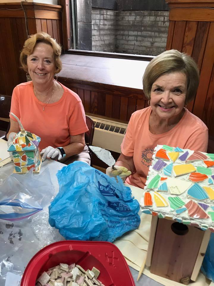 Carolee O'Hara and Sandy Votaw creating bird houses.