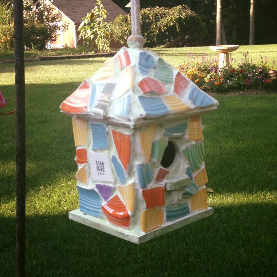 Shards from a local pottery repurposed into a beautiful bird house