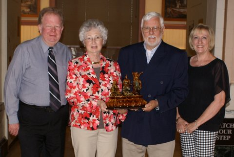 Timothy Brookes, President of the East Liverpool Historical Society (left) and Susan Weaver, Director of the Museum of Ceramics (right) accept a rare Harker Taylor inkwell from William and Donna Gray.