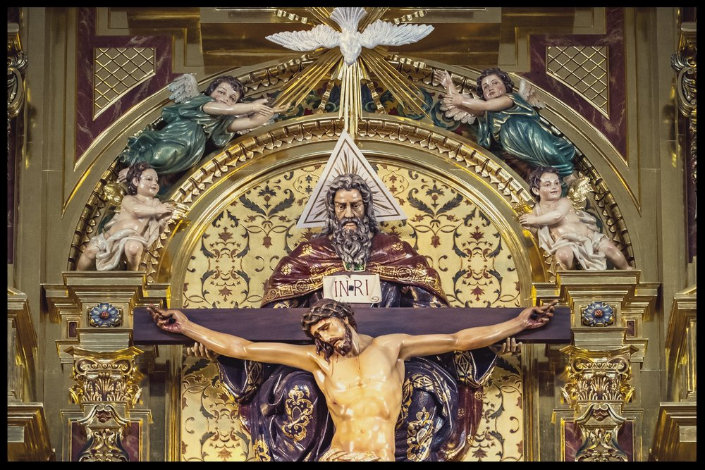 The Holy Trinity as the Throne of Mercy, with God the Father holding the Crucifix and the Holy Spirit flying above in the form of a dove. Photography by Roderick Fenn ©2017
