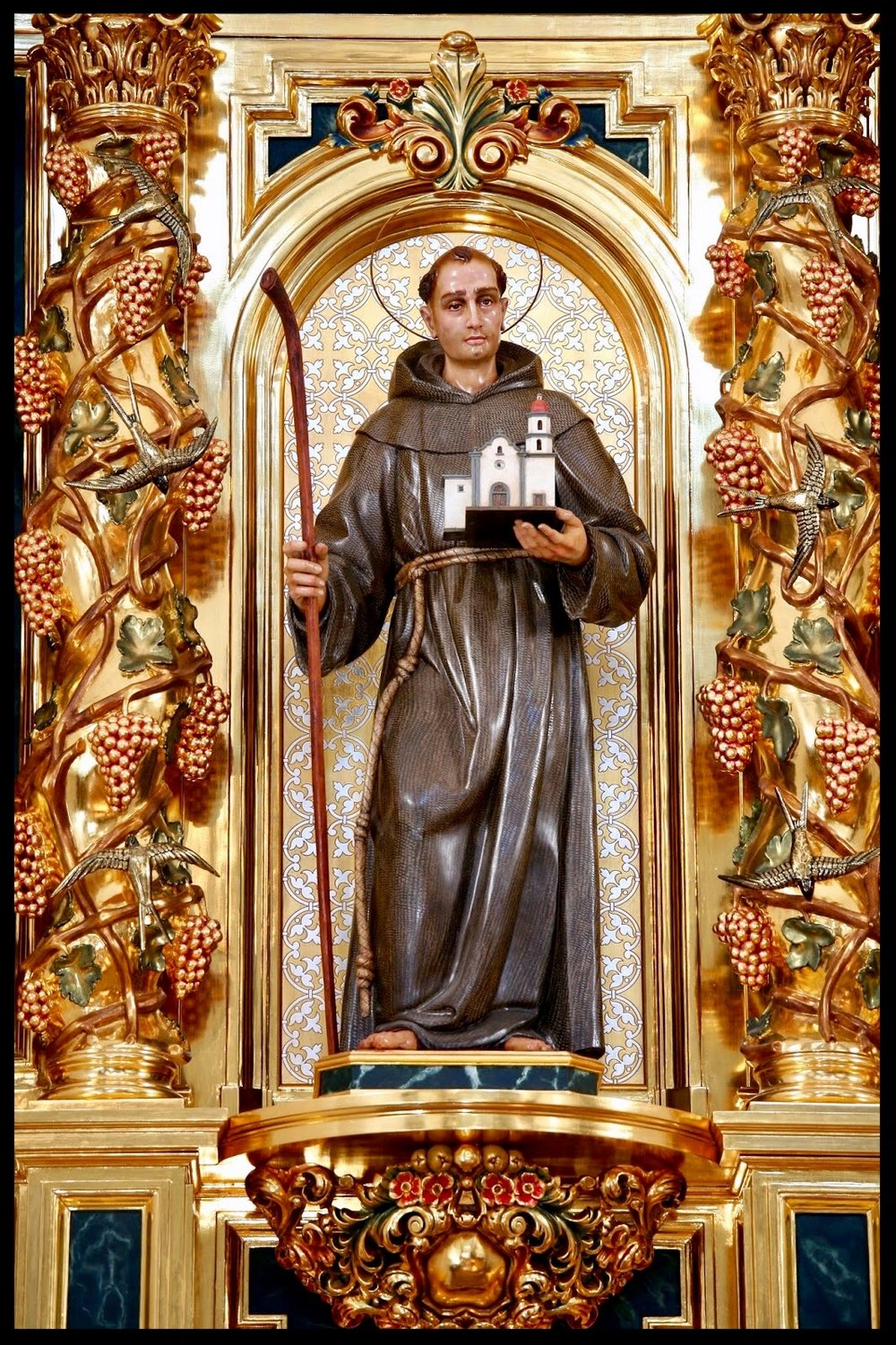 The statue of St. Junípero Serra in the Great Retablo of Mission Basilica San Juan Capistrano