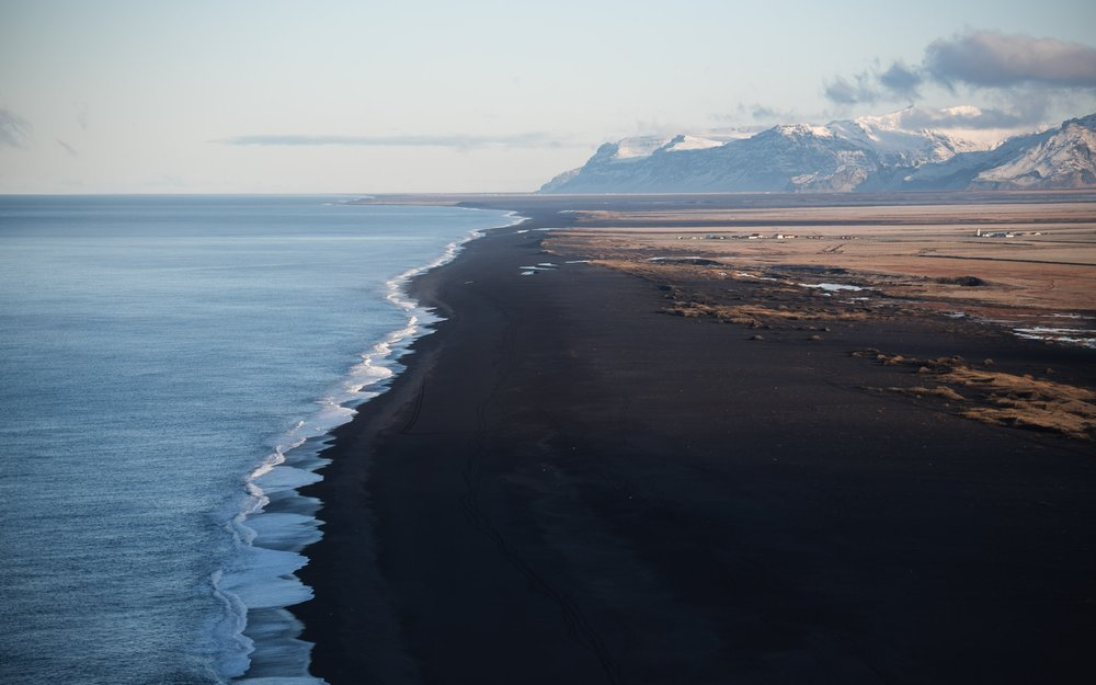The black beaches around Vík in contrast with the wild ocean.