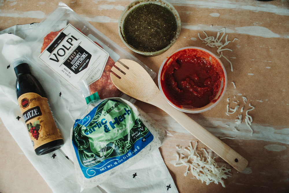 INGREDIENTS - - Pepperoni- Pesto- Pizza Sauce- Mozzarella Cheese- Balsamic Glaze- Pizza Dough