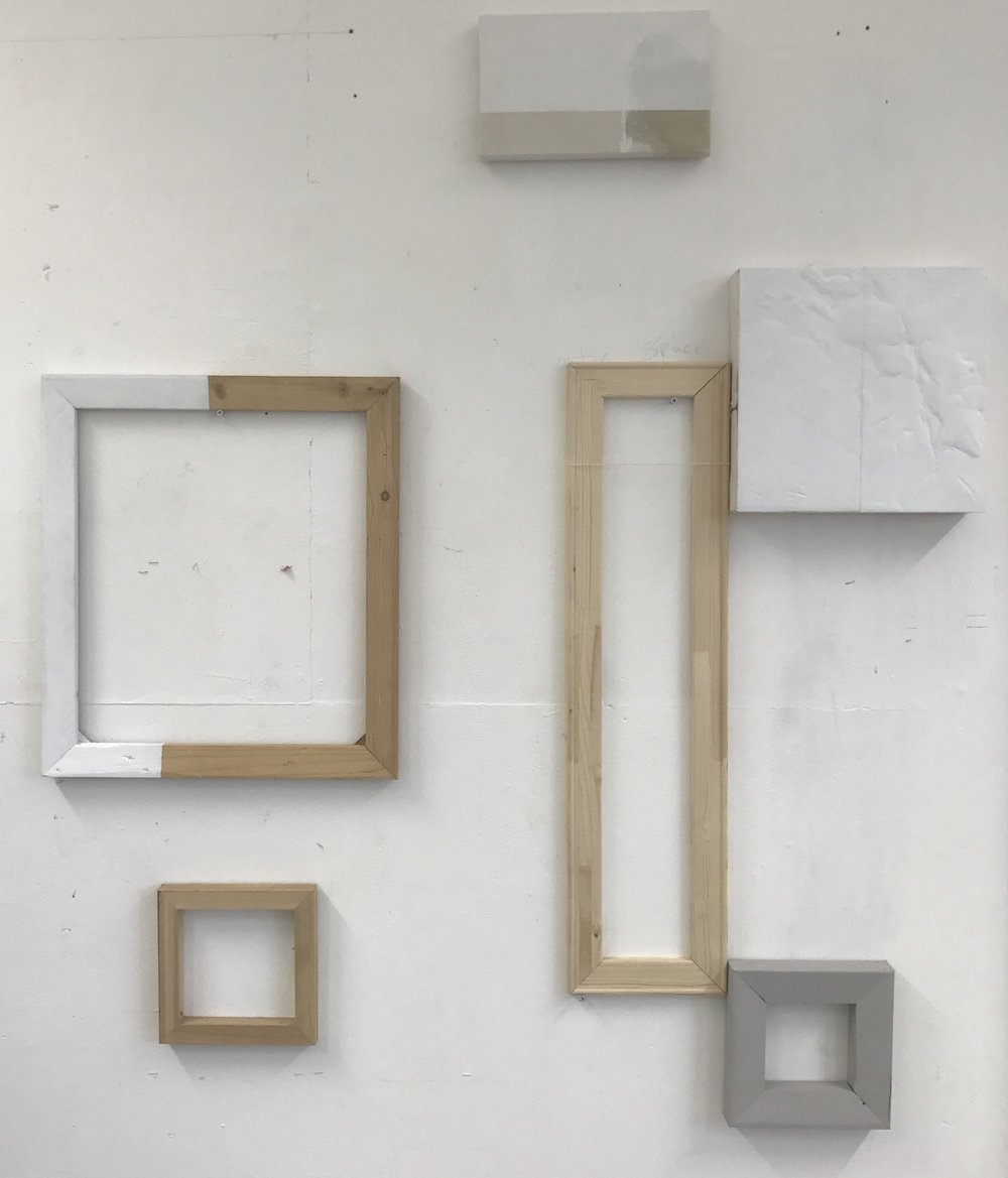 Ally McGinn (2017) Studio view.  Empty frames with a balanced aesthetic.