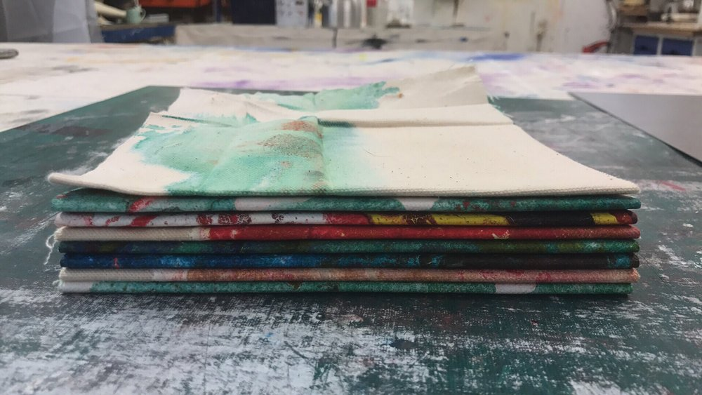 Quills grouped into sets of two, due to the thickness of the canvas and paint. Ready for binding.