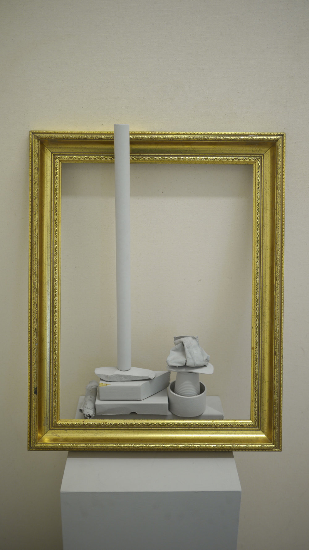 Ally McGinn (2017)  Enframed . found objects, emulsion paint, gold frame and canvas, 250 x 120 x 50 cm approximately.