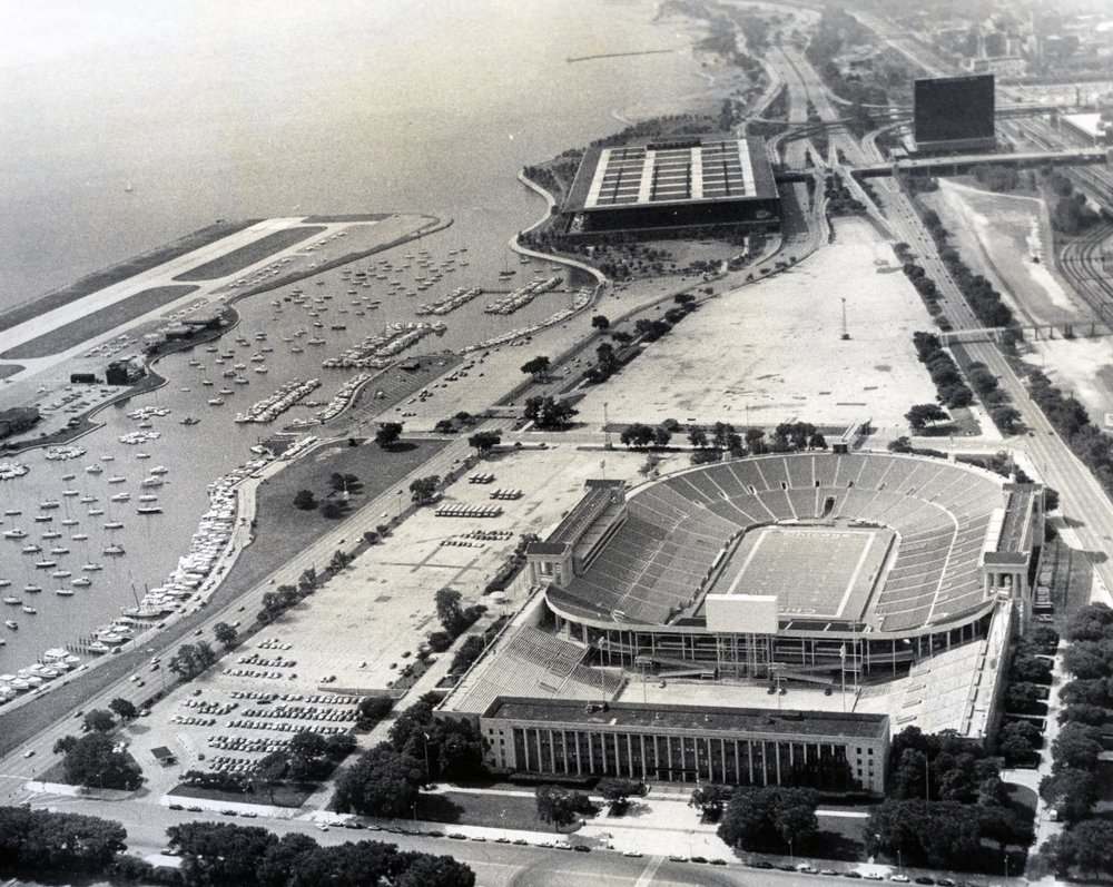 Aerial view of Chicago Park District Administration Building and Soldier Field looking south, ca. 1975.Chicago Park District Records: Photographs, Special Collections, Chicago Public Library.