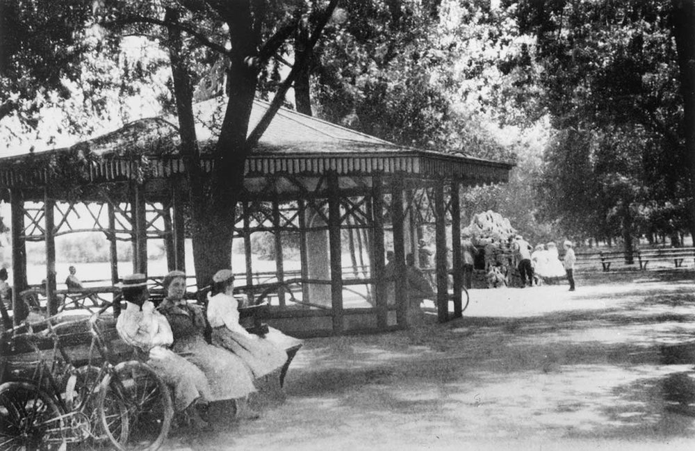 Ladies and their bicycles near the Rustic Shelter in Lincoln Park, from the  Report of the Commissioners and A History of Lincoln Park,  1899, by I.J. Bryan.