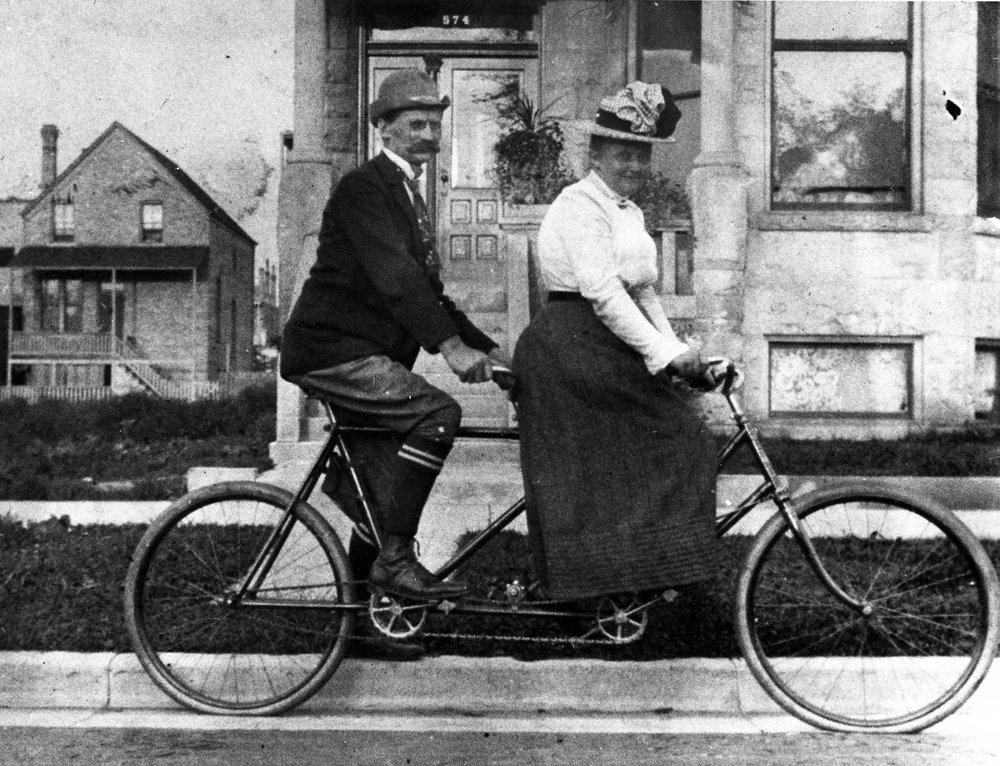 Jens and Anna Marie Jensen are depicted on a tandem bicycle in front of their apartment at 574 (now 1113) N. Sacramento Avenue. Over a 20-year period, they lived in four different apartment buildings near Humboldt Park. Ca. 1900, courtesy of Morton Arboretum Special Collections.