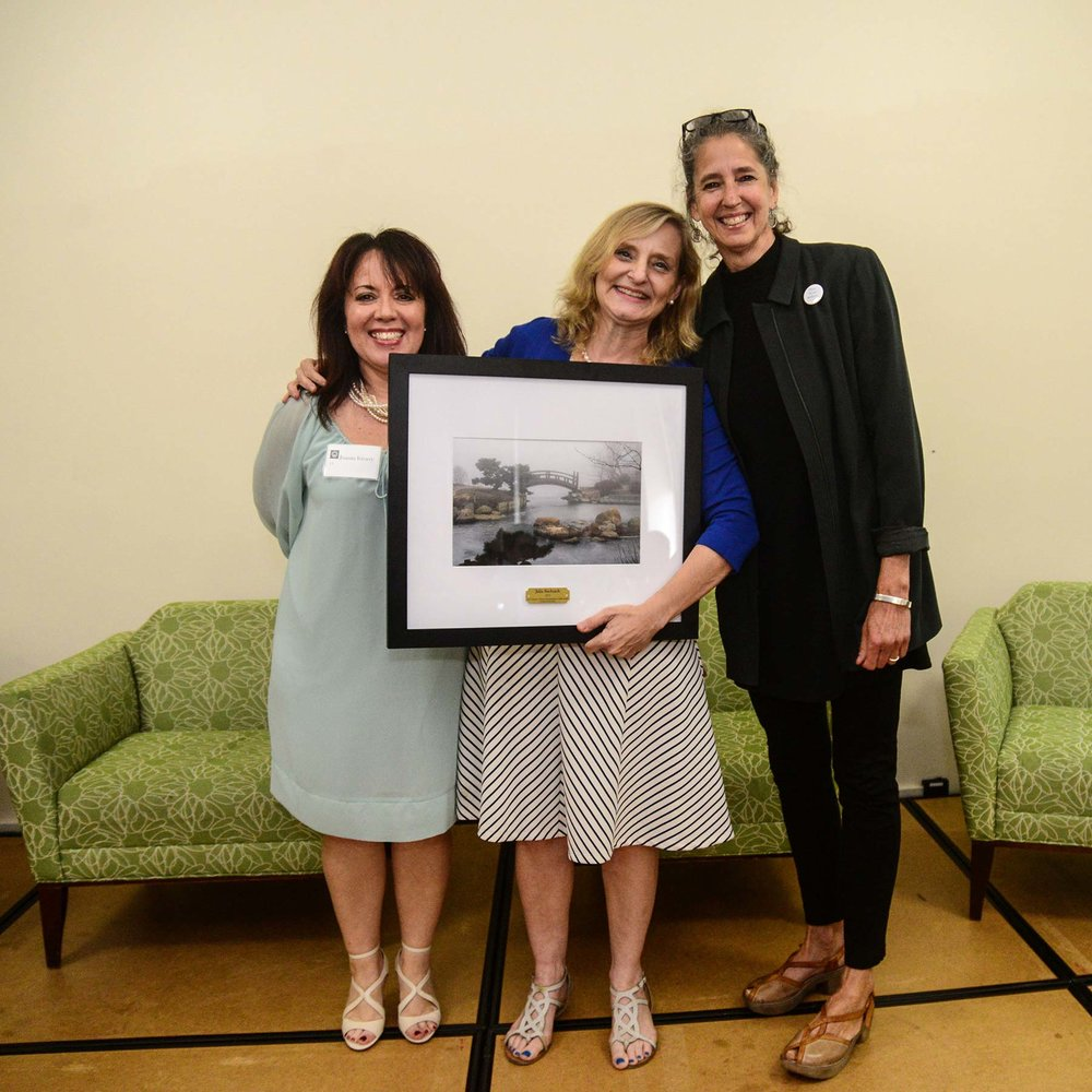 Julia Bachrach received the Friends of the Parks'  Leon Despres Lifetime Commitment to Parks Award , 2017.  Juanita Irizzary is depicted on the left and Lauren Moltz, right. Photo by Charlie Billups.