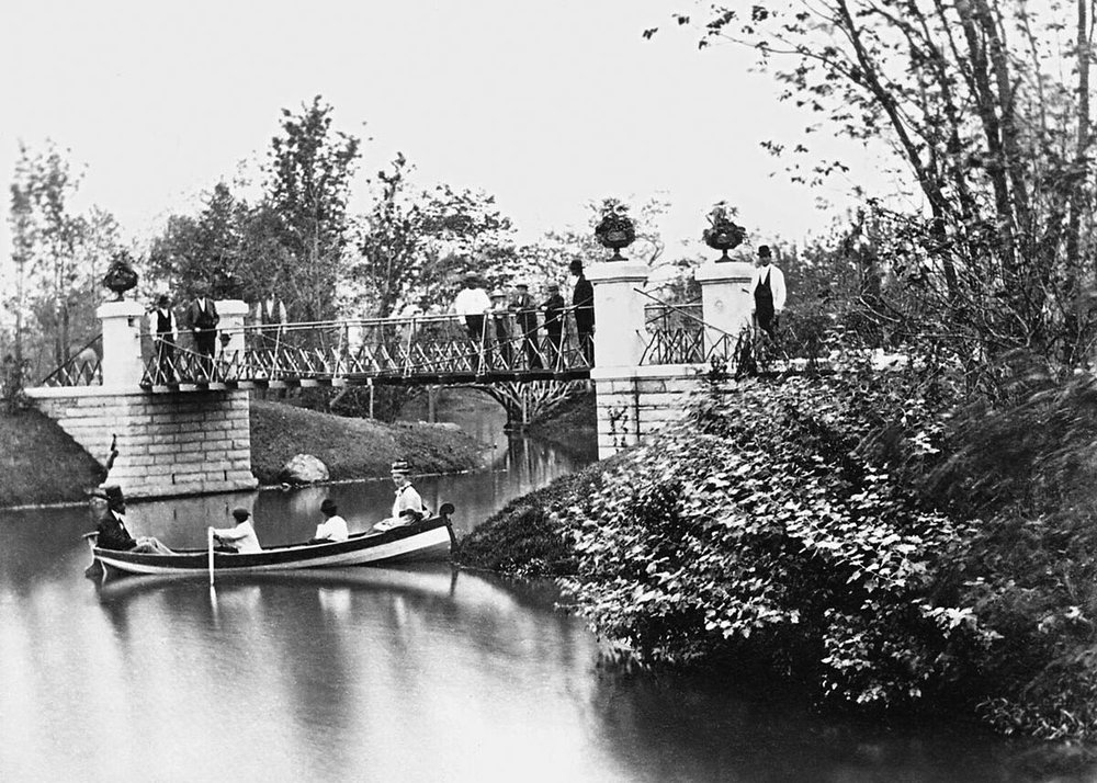 Boaters near suspension bridge in Central (Garfield) Park, 1875. From  Sixth Annual Report of West Chicago Park Commissioners .
