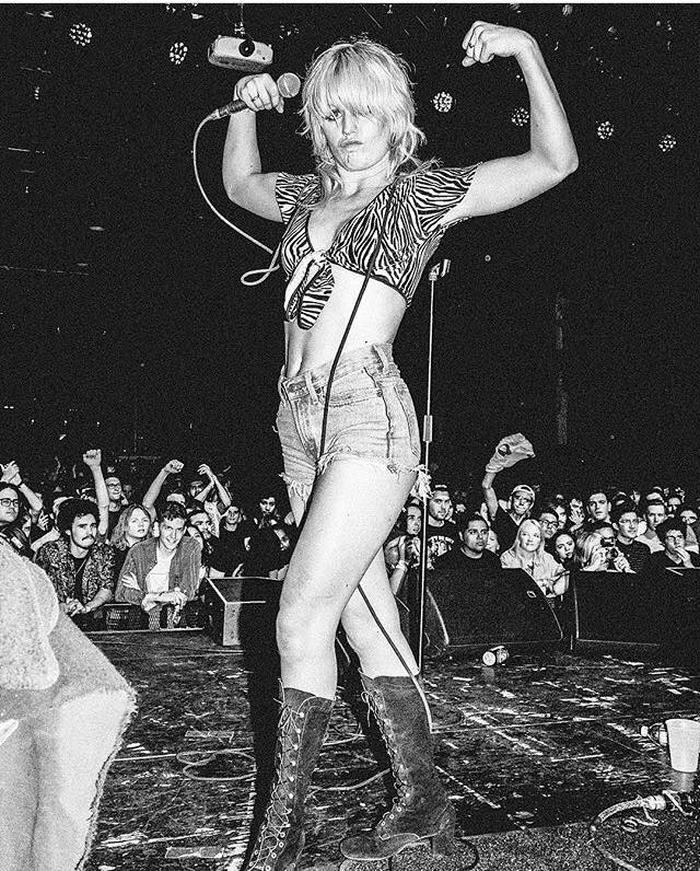 AMY TAYLORAMYL AND THE SNIFFERS - Episode 529/-/18Amy Taylor, vocalist for AMYL AND THE SNIFFERS calls in from Germany to share stories of playing her first show ever and the destruction of an audience members white pants. Living the high life backstage at a huge festival on only one beer, and the time two members got into a fight to keep from fighting on stage. In other words, just another tour for the Australian badasses. For more about AMYL AND THE SNIFFERS:https://www.amylandthesniffers.com/