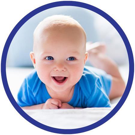 Baby Boy On Mattress Smiling
