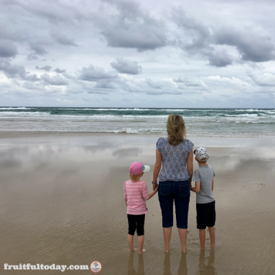 Caption:  A rare treat: taking a walk along the beach as a family (my husband is behind the camera).