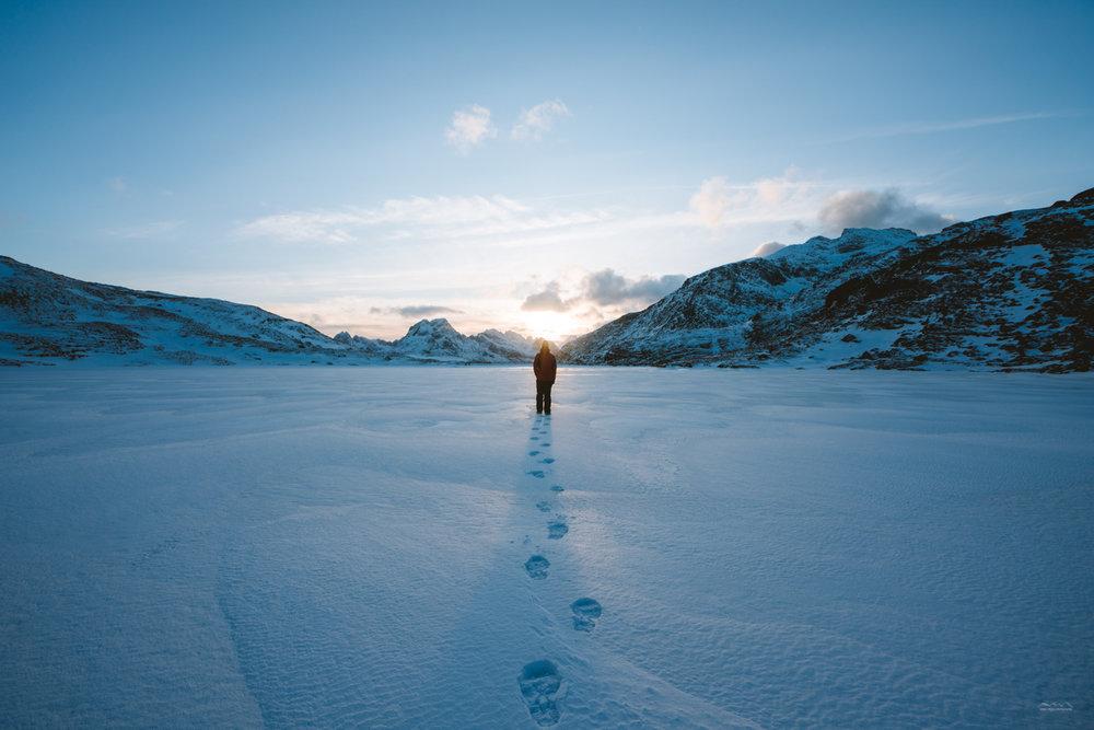 Walking through the lake Einangsvatnet at Ryten