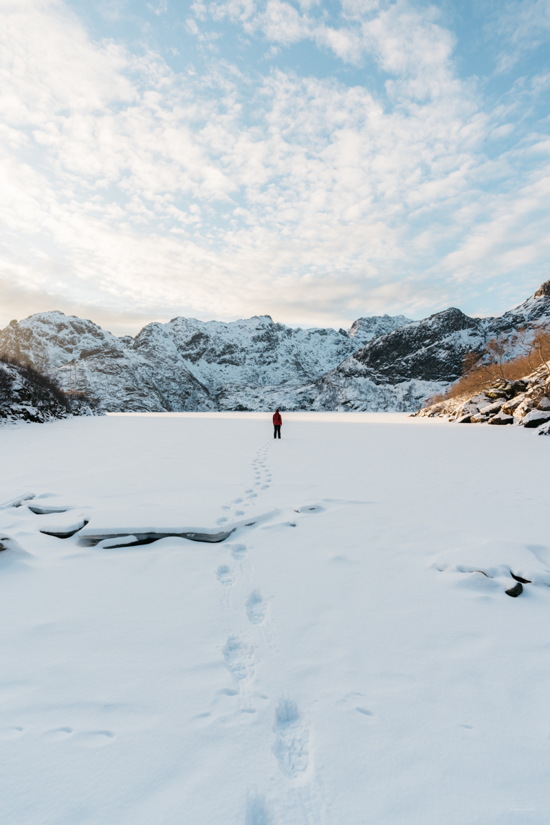 Travel photographer on a frozen lake