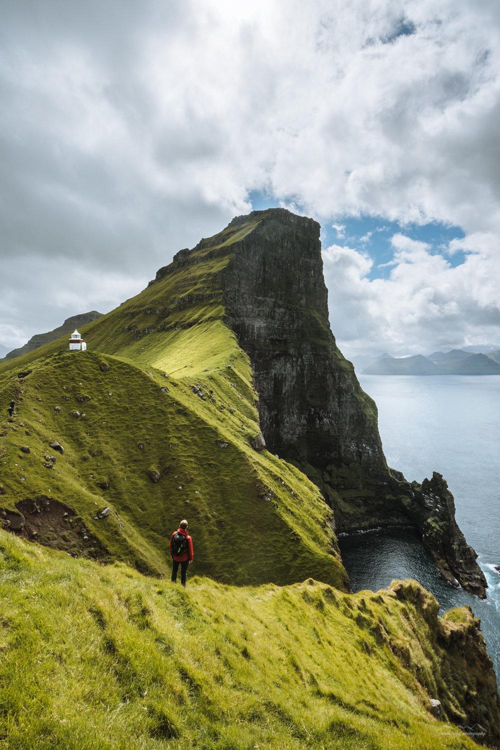 Admiring the Kallur Lighthouse. Kalsoy, Faroe Islands