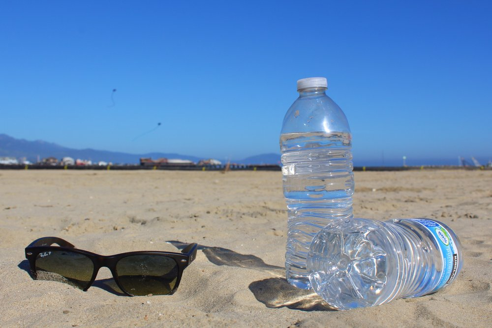 When I hit the beach, I try to bring  3-4 bottles of water  since heat causes your body to lose fluids through sweat.