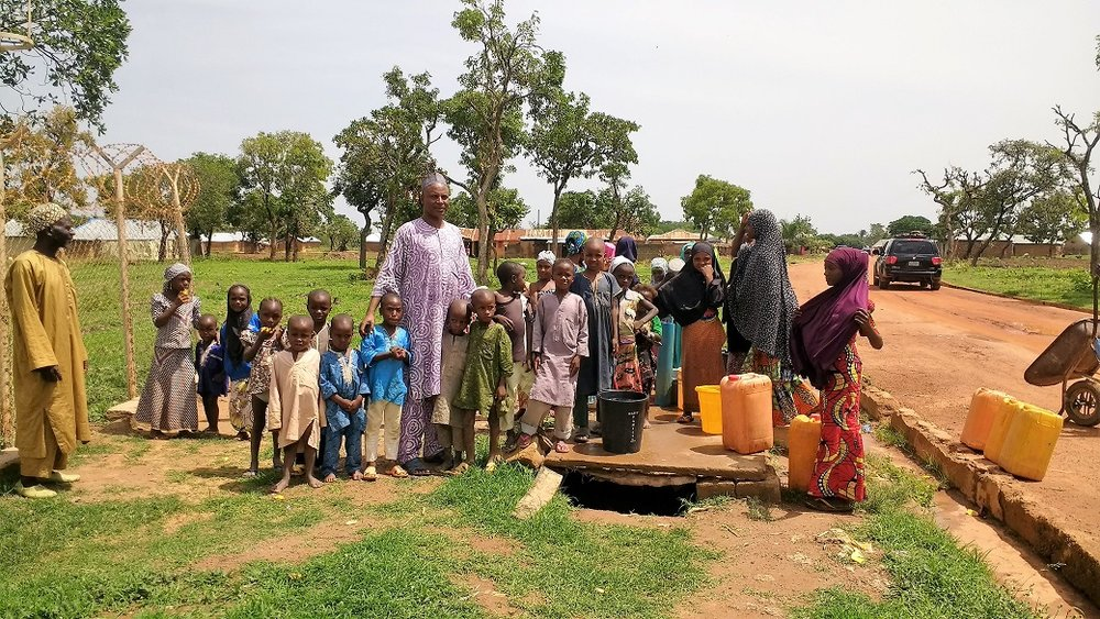 Fulani doctor with children benefiting from Ladduga solar pump replacement.jpg