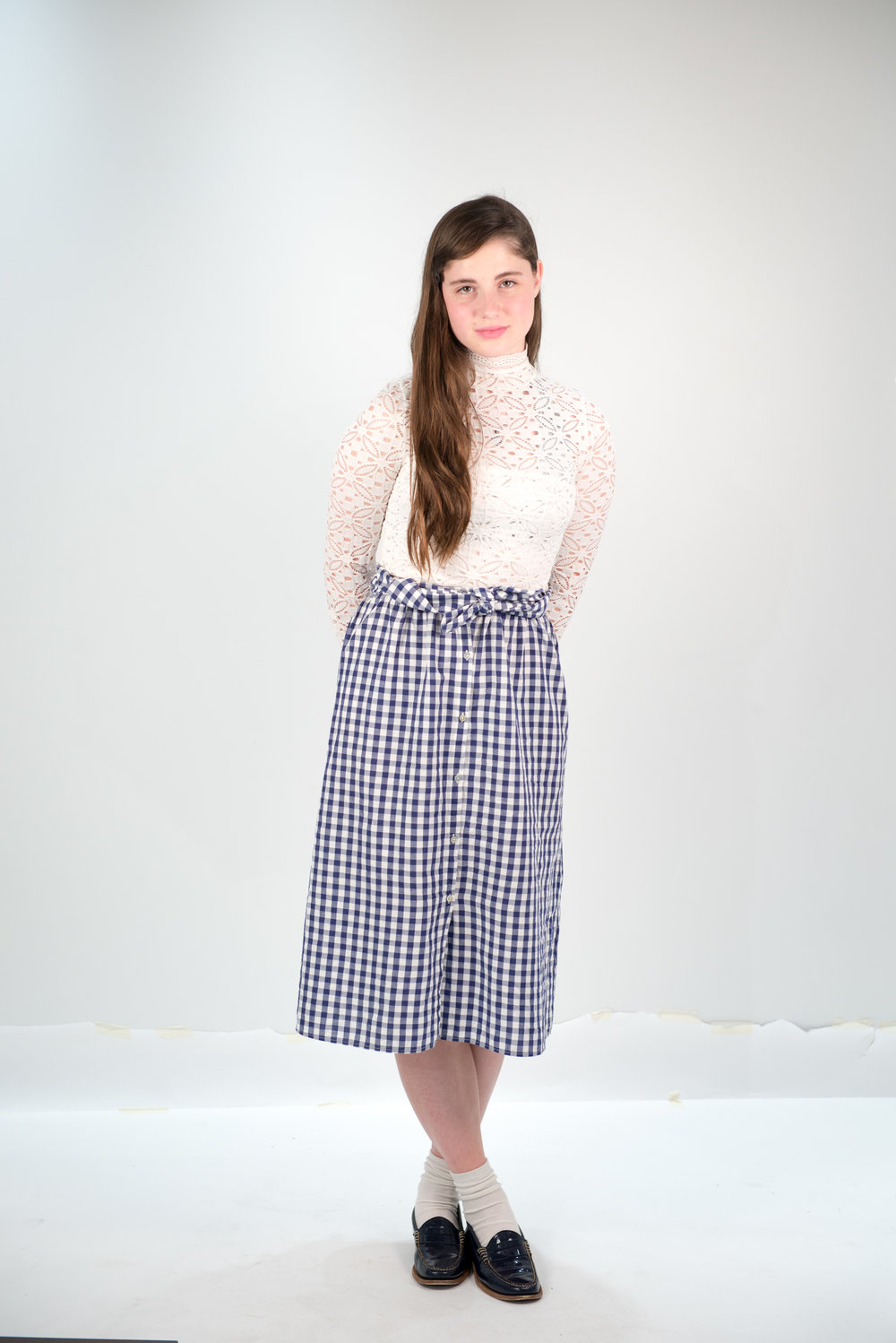 On Daisy: Zara skirt, Free People turtleneck, thrifted vintage loafers