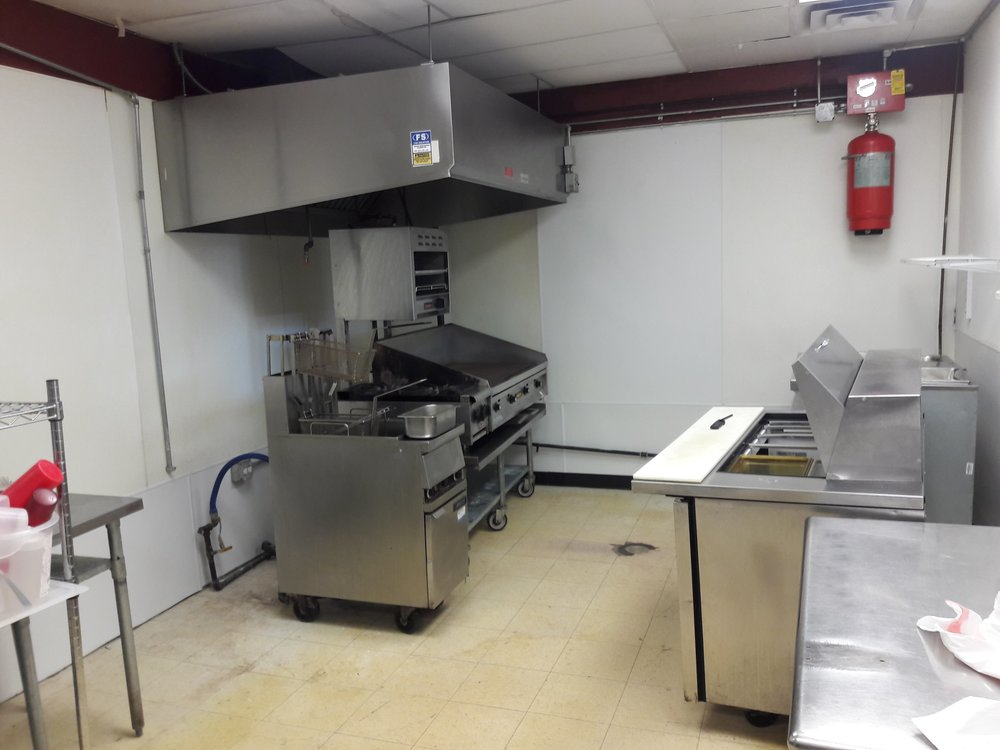 Full kitchen with a hood and deep fryer