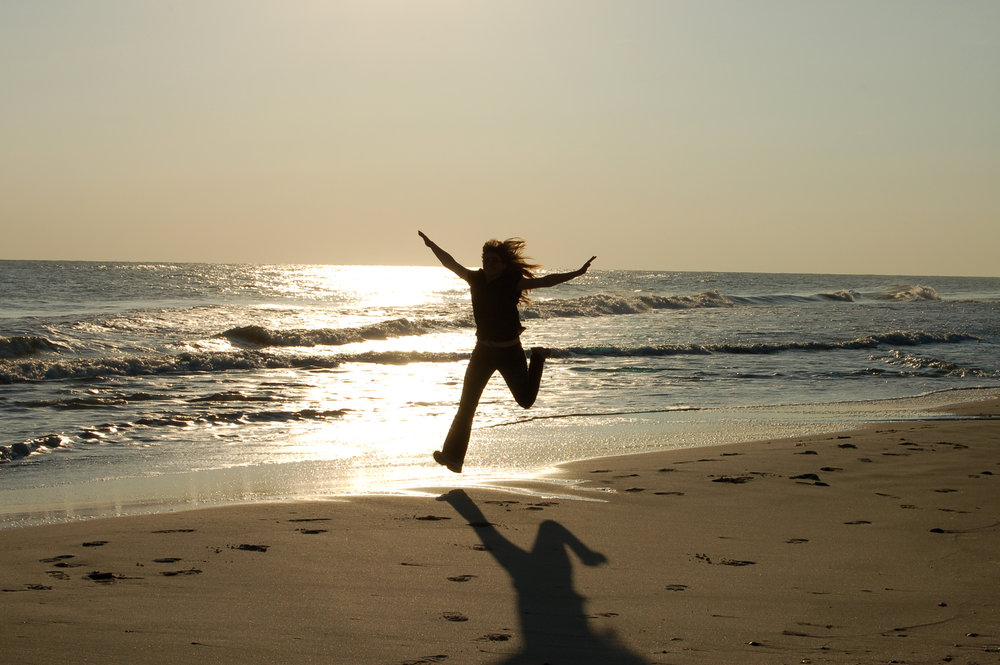girl-running-on-beach.jpg