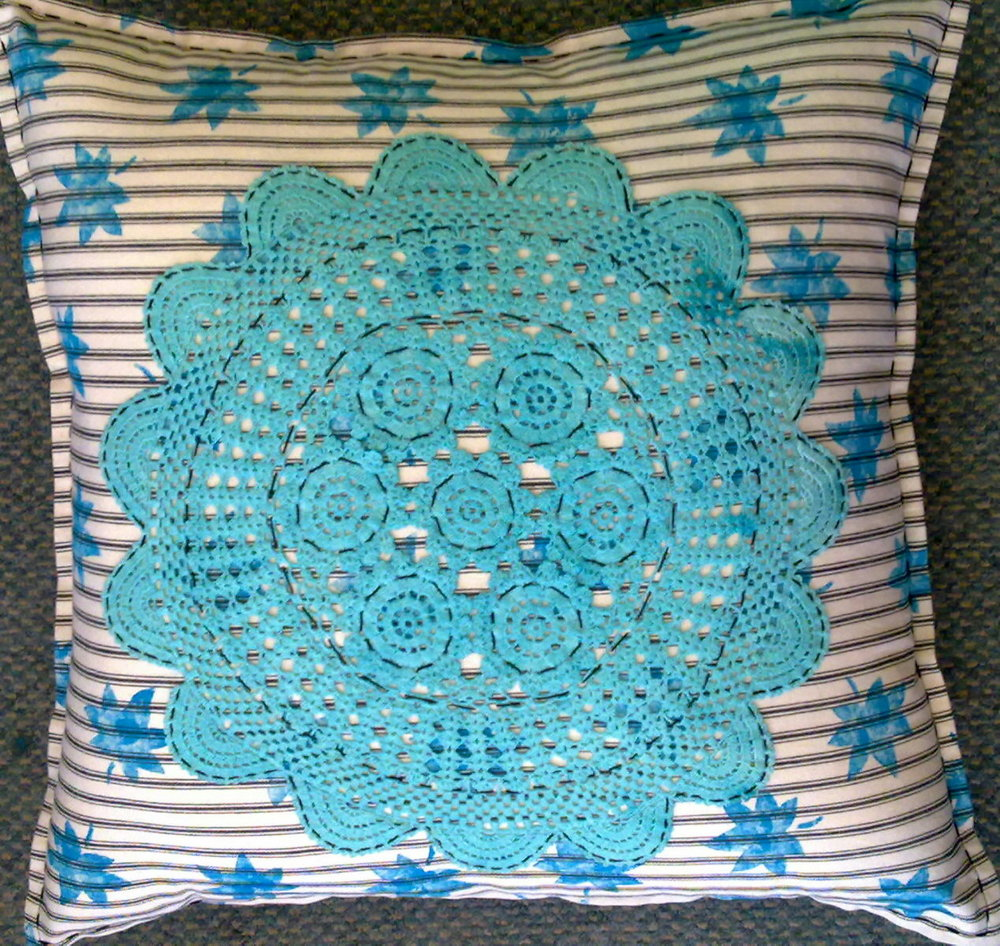 aqua doillie cushion.jpg