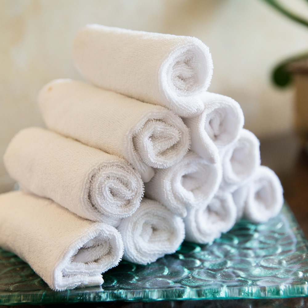 Rolled Towels - If you think the aching in your back is due to the weight of your baby + sleeping on your side, rolling a few towels to prop under your growing belly while sleeping/lying down can help relieve some of that pressure.