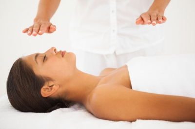 Note: Clients are dressed during Reiki treatments. This photo is of a woman during a Reiki Massage.