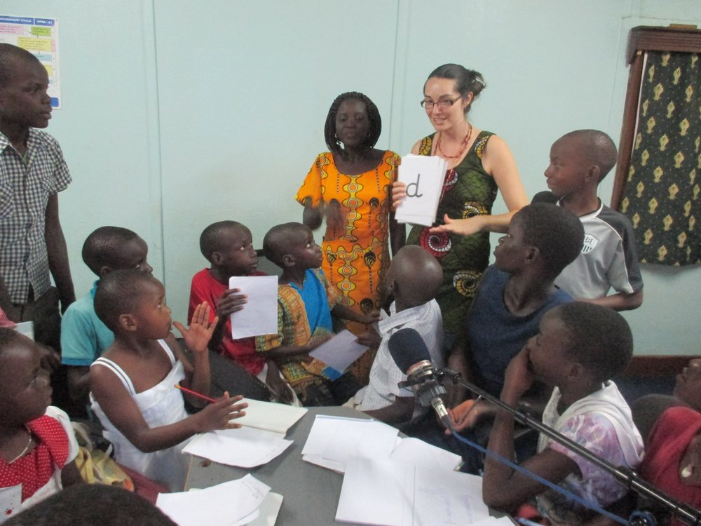 Teacher Jody and Teacher Catherine working with pupils for MEGA FM classroom