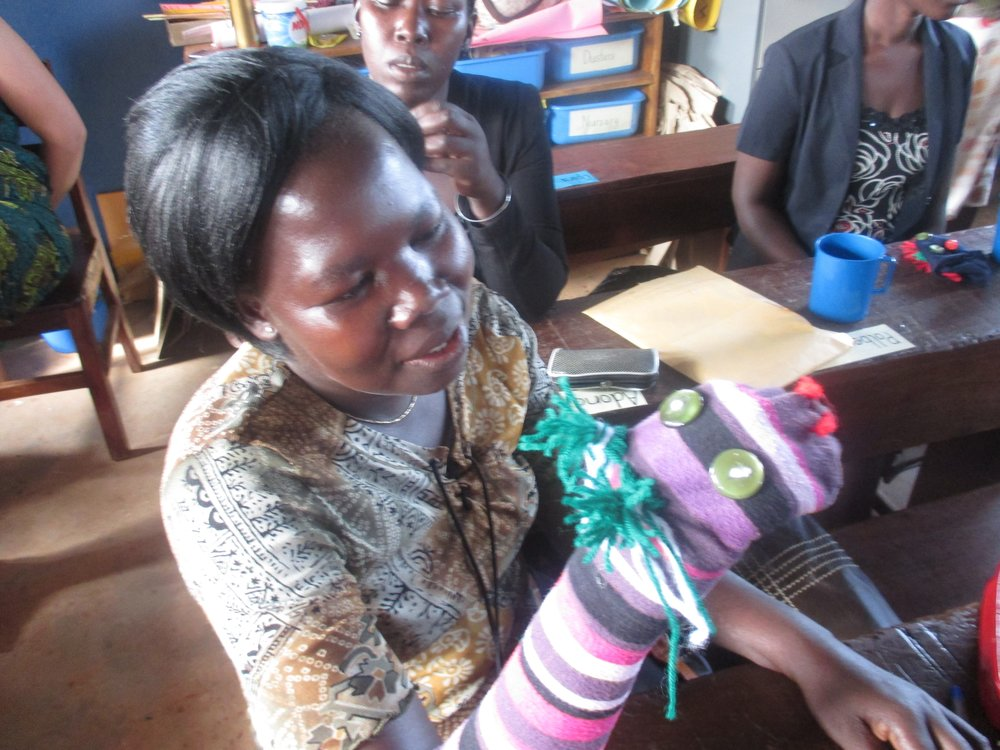 A teacher creating Phonemic Awareness with her new puppet.