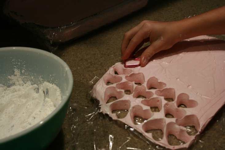 Cutting out little hearts and coating them with even more sugar