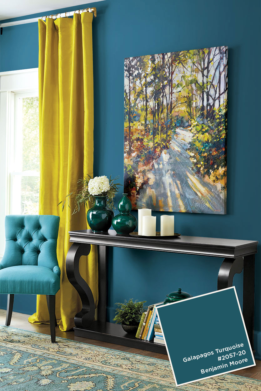 Find a piece of artwork to use as an inspiration piece to help pick a wall color as well as accent colors for the curtains and furniture.