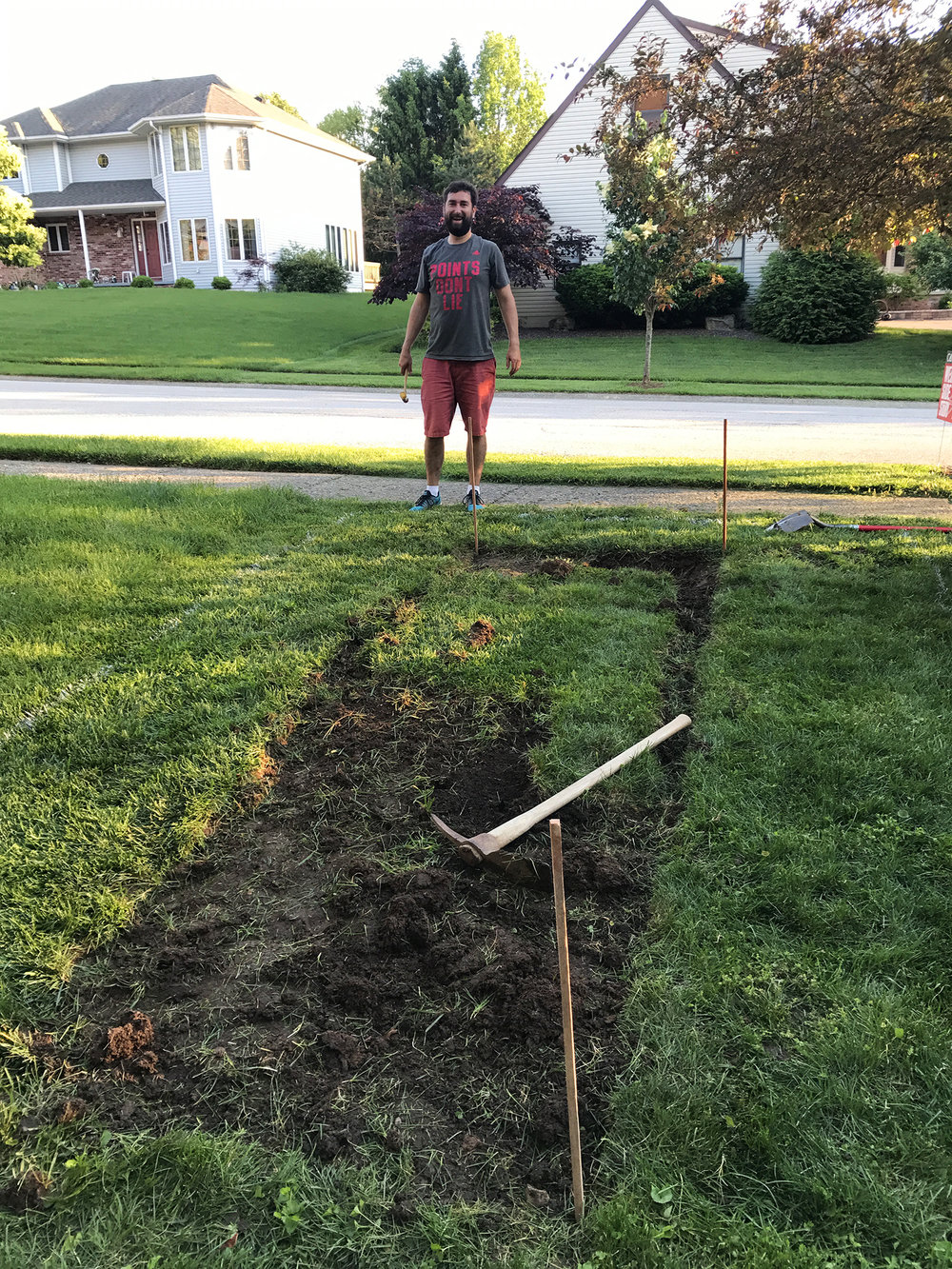Justin helping out eliminating the sod under the beds.