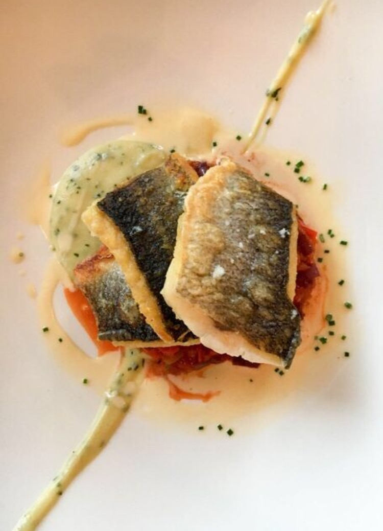 pan fried sea bass with aubergine, caponata, celery and basil