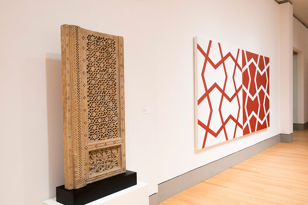 Left: Mughal Jali Screen. 18th century. Sandstone.  Right: Jali XXVI: Sashay Red and White. 2011. Acrylic on two canvases. 72 x 144 in., 182.9 x 365.8 cm.