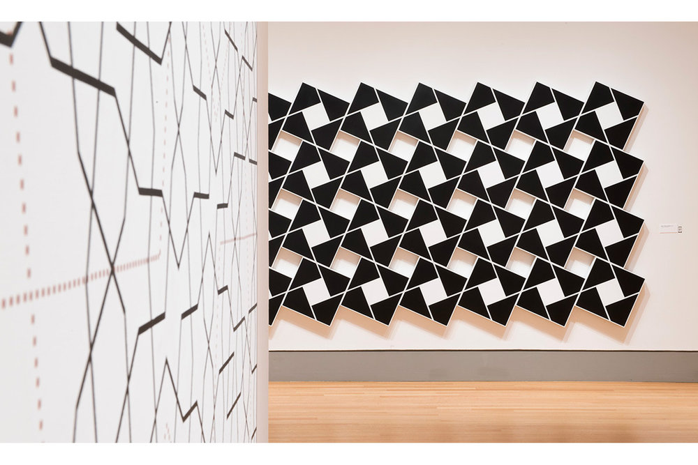 Foreground: Topkapi XXI. 2012. Acrylic on canvas. 72 x 72 in., 182.9 x 182.9 cm.  Background: Ajlun I: Black Pearl and White. 2002. Acrylic on 32 canvases. 80 x 168 in., 203.2 x 426.7 cm.