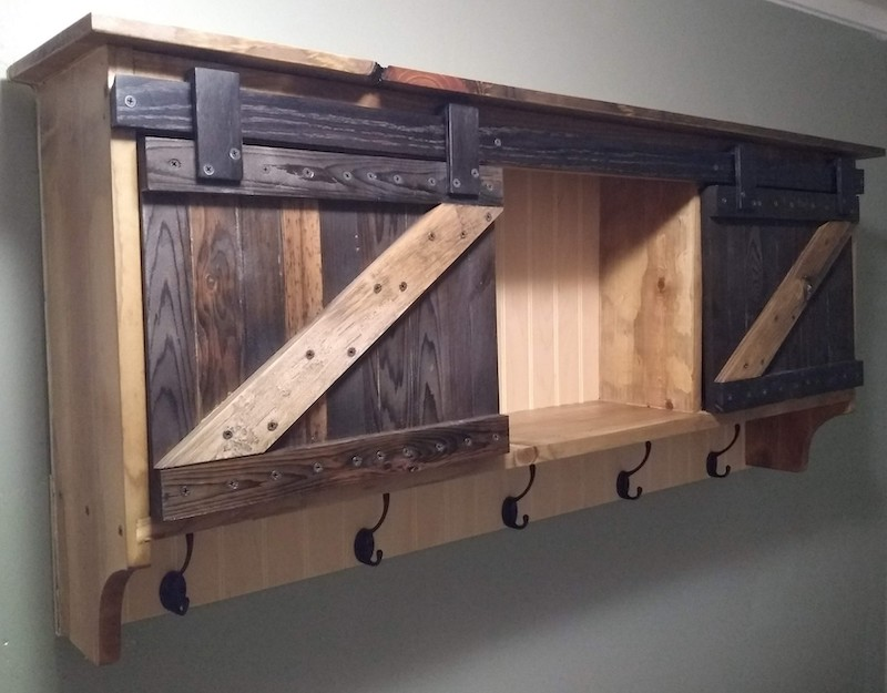 Rustic Wall cabinet - This wall cabinet has hand made barn door hardware and is naturally aged wood(not stained), with 3 cubbies, a top shelf and 5 coat racks. Great entryway or mudroom cabinet and goes perfect above a rustic bench. $350