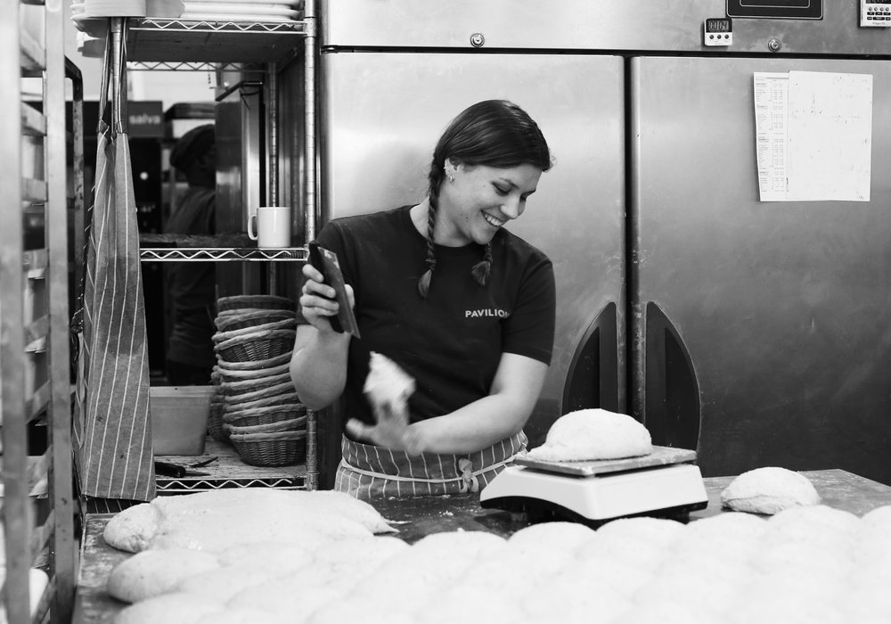 Baker girl Suzi weighing up those bad boy loaves.