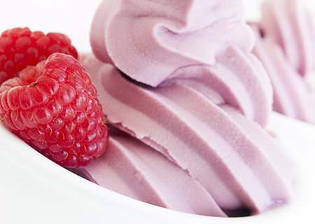 Rasberry Cream   Tangy raspberries reduced into a jam and  blended into our sweet cream soft-serve like base.   (NF, GF)