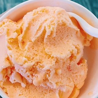 Orange Sherbert - Fresh, zesty orange sherbet made with 2% milk. Also available in a variety of other fruit flavors- simply ask our chefs!(NF, GF)