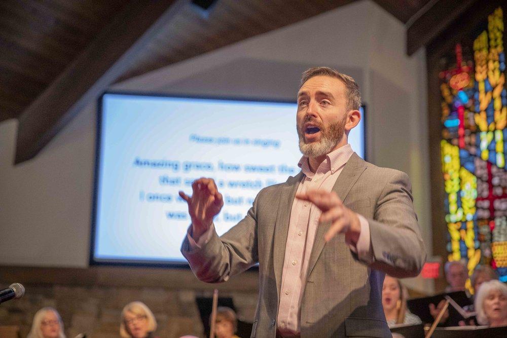Ryan Main conducting the congregation