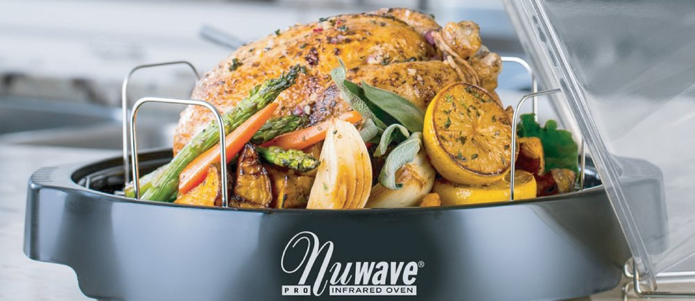 cooked rotisserie chicken sitting in a NuWave oven with lid open