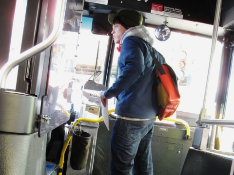 man boarding a public bus in chicago