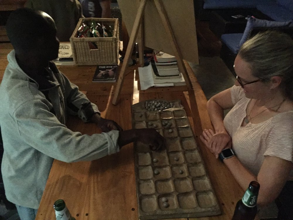 Bawo lessons. Bawo is extremely common in Sub-Saharan Africa. It is a complicated version of Mancala, and there are many variations.