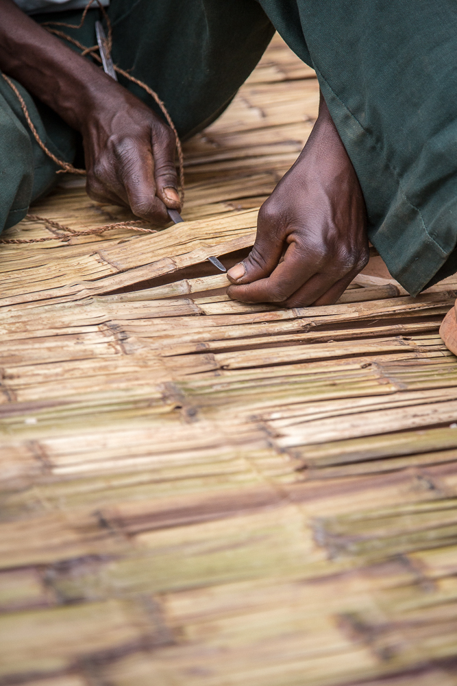 This man was making bamboo mats, which are used as beds.