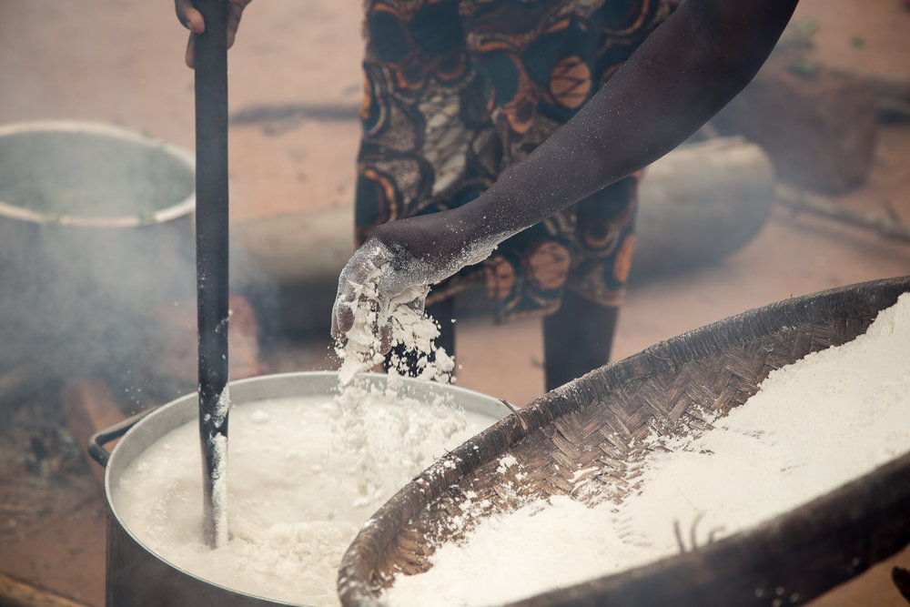The maize flour is integrated into boiling water, cooked, stirred, cooked, etc... until the Nsima is ready to eat. It is hard work, and the smoke from the fire can be overwhelming, so there is a lot of taking turns.
