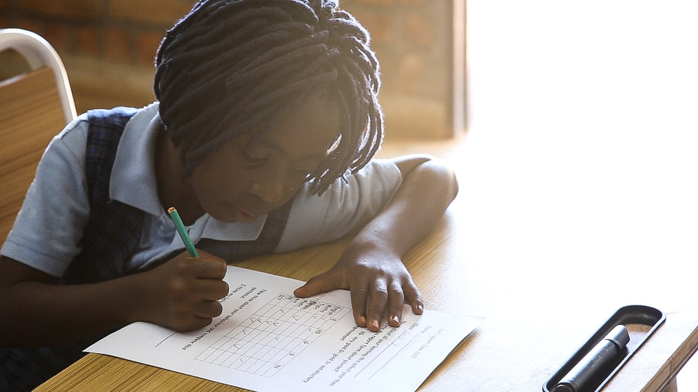 A student at Mzuzu Academy. Currently, about 25% of the students are on scholarships (funded by donations, Kwithu Kitchens, and the 75% of the students that are full-tuition).
