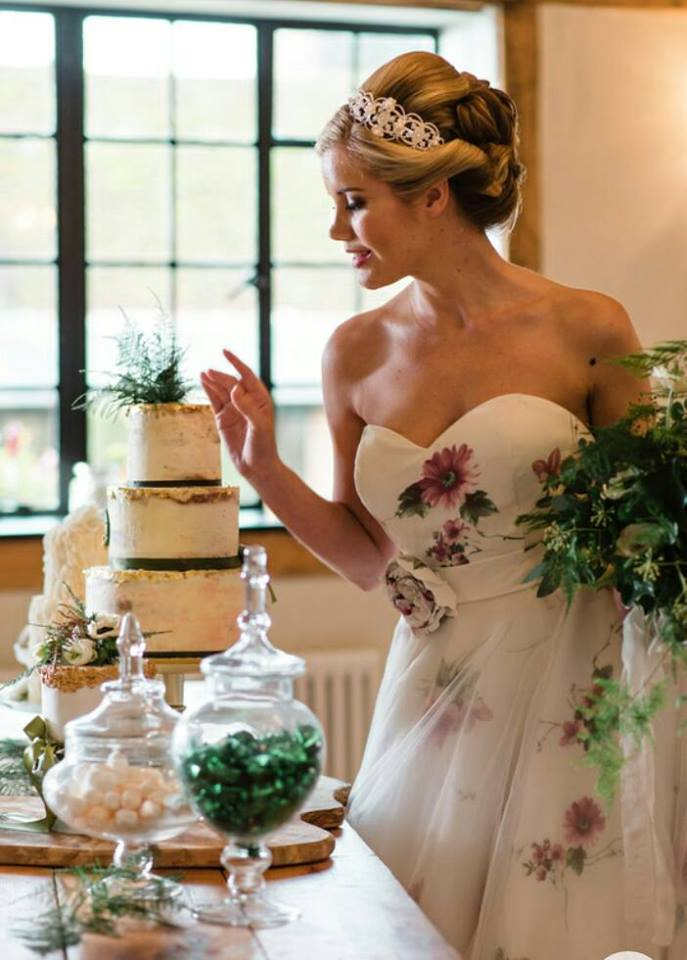 Model wearing a floral strapless princess style wedding dress